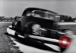 Image of road testing of cars Michigan United States USA, 1938, second 12 stock footage video 65675030004