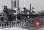 Image of Ford River Rouge Plant raw material storage Dearborn Michigan USA, 1927, second 1 stock footage video 65675030033