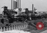 Image of Ford River Rouge Plant raw material storage Dearborn Michigan USA, 1927, second 5 stock footage video 65675030033