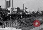 Image of Ford River Rouge Plant raw material storage Dearborn Michigan USA, 1927, second 9 stock footage video 65675030033