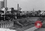 Image of Ford River Rouge Plant raw material storage Dearborn Michigan USA, 1927, second 11 stock footage video 65675030033