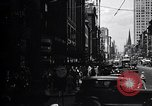Image of busy city street with pedestrian traffic Detroit Michigan USA, 1926, second 2 stock footage video 65675030056