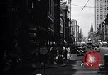 Image of busy city street with pedestrian traffic Detroit Michigan USA, 1926, second 3 stock footage video 65675030056