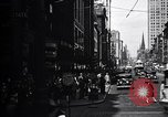 Image of busy city street with pedestrian traffic Detroit Michigan USA, 1926, second 4 stock footage video 65675030056