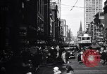 Image of busy city street with pedestrian traffic Detroit Michigan USA, 1926, second 6 stock footage video 65675030056
