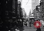 Image of busy city street with pedestrian traffic Detroit Michigan USA, 1926, second 7 stock footage video 65675030056