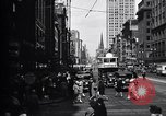 Image of busy city street with pedestrian traffic Detroit Michigan USA, 1926, second 8 stock footage video 65675030056