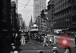 Image of busy city street with pedestrian traffic Detroit Michigan USA, 1926, second 11 stock footage video 65675030056