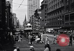 Image of busy city street with pedestrian traffic Detroit Michigan USA, 1926, second 12 stock footage video 65675030056