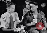 Image of workers have lunch Detroit Michigan USA, 1952, second 2 stock footage video 65675030075
