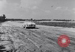 Image of Ford automobiles being road tested Dearborn Michigan USA, 1951, second 6 stock footage video 65675030130