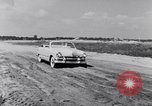 Image of Ford automobiles being road tested Dearborn Michigan USA, 1951, second 7 stock footage video 65675030130
