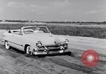 Image of Ford automobiles being road tested Dearborn Michigan USA, 1951, second 8 stock footage video 65675030130