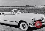 Image of Ford automobiles being road tested Dearborn Michigan USA, 1951, second 10 stock footage video 65675030130