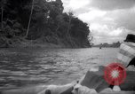 Image of natives in canoes Devil's Island French Guiana, 1939, second 2 stock footage video 65675030237