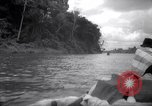 Image of natives in canoes Devil's Island French Guiana, 1939, second 5 stock footage video 65675030237