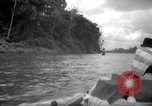 Image of natives in canoes Devil's Island French Guiana, 1939, second 7 stock footage video 65675030237