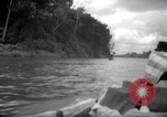 Image of natives in canoes Devil's Island French Guiana, 1939, second 8 stock footage video 65675030237