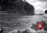 Image of natives in canoes Devil's Island French Guiana, 1939, second 10 stock footage video 65675030237