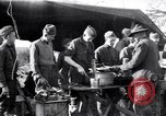 Image of American soldiers being fed at a field kitchen France, 1918, second 1 stock footage video 65675030276