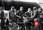 Image of American soldiers being fed at a field kitchen France, 1918, second 2 stock footage video 65675030276