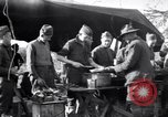 Image of American soldiers being fed at a field kitchen France, 1918, second 4 stock footage video 65675030276