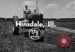 Image of tractor powered generator Hinsdale Illinois USA, 1954, second 3 stock footage video 65675030289