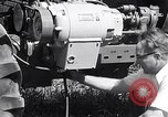 Image of tractor powered generator Hinsdale Illinois USA, 1954, second 12 stock footage video 65675030289