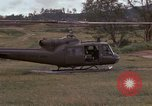 Image of UH 1D helicopter Vietnam, 1966, second 12 stock footage video 65675030314