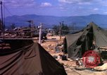 Image of attacked signal site Ankhe South Vietnam, 1966, second 10 stock footage video 65675030371