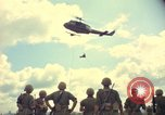 Image of helicopter rappel Ankhe South Vietnam, 1966, second 8 stock footage video 65675030386