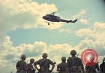 Image of helicopter rappel Ankhe South Vietnam, 1966, second 10 stock footage video 65675030386