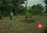 Image of clearing brush Ankhe South Vietnam, 1965, second 5 stock footage video 65675030389