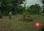Image of clearing brush Ankhe South Vietnam, 1965, second 6 stock footage video 65675030389