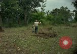 Image of clearing brush Ankhe South Vietnam, 1965, second 12 stock footage video 65675030389