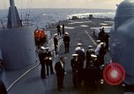 Image of HUS1 UH-34D Seahorse lands on USS North Hampton Atlantic Ocean, 1962, second 6 stock footage video 65675030397