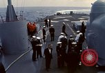 Image of HUS1 UH-34D Seahorse lands on USS North Hampton Atlantic Ocean, 1962, second 8 stock footage video 65675030397