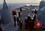 Image of HUS1 UH-34D Seahorse lands on USS North Hampton Atlantic Ocean, 1962, second 11 stock footage video 65675030397