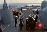 Image of HUS1 UH-34D Seahorse lands on USS North Hampton Atlantic Ocean, 1962, second 12 stock footage video 65675030397