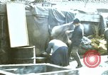 Image of Koreans loading wheat at dock South Korea, 1968, second 1 stock footage video 65675030472