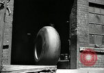 Image of workers rolling large tire tubes Akron Ohio USA, 1941, second 4 stock footage video 65675030483