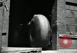 Image of workers rolling large tire tubes Akron Ohio USA, 1941, second 5 stock footage video 65675030483