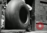 Image of workers rolling large tire tubes Akron Ohio USA, 1941, second 7 stock footage video 65675030483