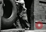 Image of workers rolling large tire tubes Akron Ohio USA, 1941, second 8 stock footage video 65675030483