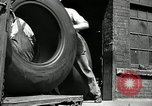 Image of workers rolling large tire tubes Akron Ohio USA, 1941, second 11 stock footage video 65675030483