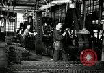 Image of half track tread assembly line Akron Ohio USA, 1941, second 2 stock footage video 65675030485