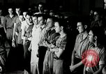Image of Goodyear employees slogan Akron Ohio USA, 1941, second 7 stock footage video 65675030572