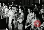 Image of Goodyear employees slogan Akron Ohio USA, 1941, second 9 stock footage video 65675030572