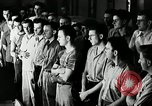 Image of Goodyear employees slogan Akron Ohio USA, 1941, second 10 stock footage video 65675030572