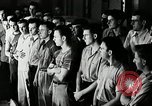 Image of Goodyear employees slogan Akron Ohio USA, 1941, second 11 stock footage video 65675030572